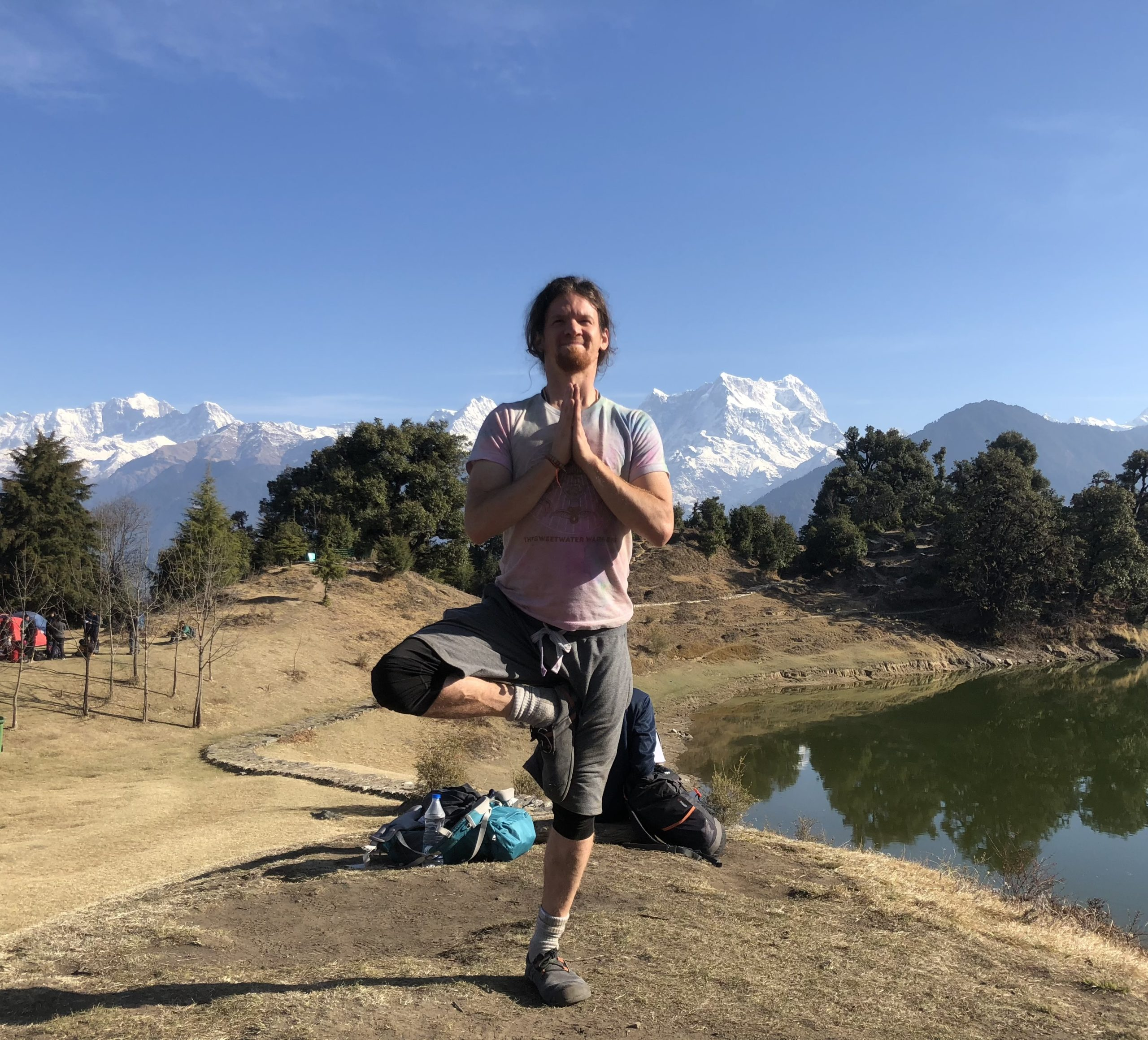Yoga instructor joe in front of mountains.